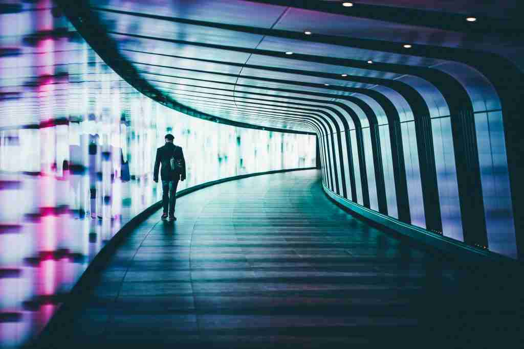 man walking along hall
